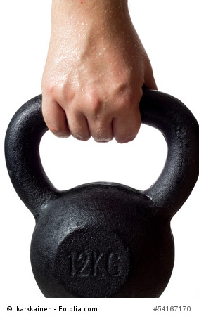 Lifting a kettlebell